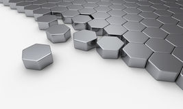 Array of hexagons on white surface. An array of close packed silver 6 sided hexagons with a few  pieces displaced on white surface Royalty Free Stock Photos
