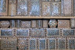 Selection of luxury ornate pearl inlaid boxes for sale in the market square souq of Marrakesh stock images