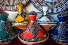 Selection of tagines for sale in the market square souq of Marrakesh. Array of items for sale to tourists in the local medina souq market square royalty free stock photo