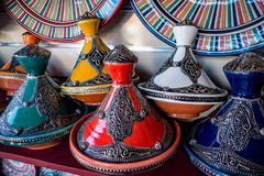 Selection of tagines for sale in the market square souq of Marrakesh. Array of items for sale to tourists in the local medina souq market square stock photos