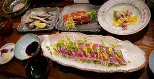 An array of Japanese grilled seafood dishes. Royalty Free Stock Photo