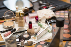 Array of Makeup. An array of makeup is shown, to be used on a bride.  Pictured is blush, foundation, lip gloss, lipstick, brushes, lotions, powders, eyeliner Stock Photo