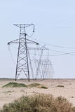 Array Of Electric Pylons On A Clear Sky In Desert Royalty Free Stock Images