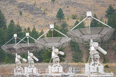 Array of parabolic antennae looking into space Stock Photos