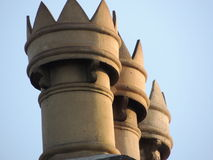 Array of princely chimney pots. Victorian chimney pots with crowns Stock Photo