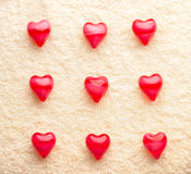 Array of red nine hearts on towel Royalty Free Stock Photography