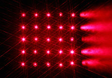 Array of red semiconductor lasers in the dark Royalty Free Stock Photos