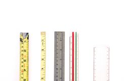 Array of Rulers & Measuring Tools. On White Surface stock photos