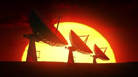 Array of satellite dishes at sunrise. 4k