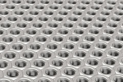Array of Silver Machine Nuts in a symmetrical pattern Stock Photography