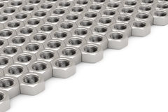 Array of Silver Machine Nuts in a symmetrical pattern Stock Photo