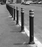 Array of street pylons. Perspective view of sidewalk pillars Stock Images