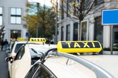 Array of taxi cabs parked Stock Photo