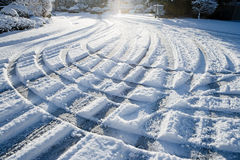 Array of tire tracks in the snow Royalty Free Stock Photography