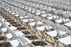 Array of White Chairs Royalty Free Stock Image