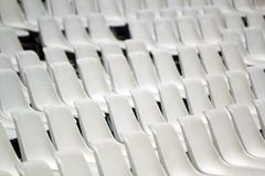 Array of white chairs Royalty Free Stock Photography