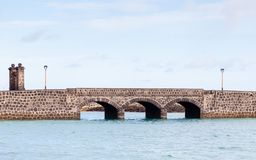 Arrecife Bridge on the Spanish island of Lanzarote. A stone bridge in the port city of Arrecife on the Spanish island of Lanzarote Stock Photography