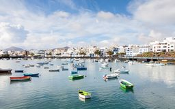 Fishing boats in the laguna `Charco de San Gines` in Arrecife. Arrecife is a Spanish port city on the island of Lanzarote Royalty Free Stock Photography