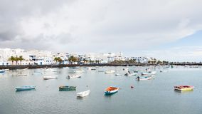 Fishing boats in the laguna `Charco de San Gines` in Arrecife. Arrecife is a Spanish port city on the island of Lanzarote Stock Image