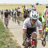 Arredondo Moreno Riding on a Cobblestone Road - Tour de France 2 Royalty Free Stock Photos