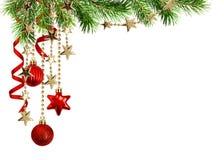 Arreglo con las ramitas verdes del pino, decorat rojo colgante de la Navidad Fotografía de archivo libre de regalías