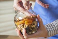 Arreglo de los frutos secos en un tarro Imágenes de archivo libres de regalías