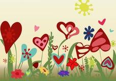Arreglo floral de corazones en un fondo amarillo Foto de archivo libre de regalías