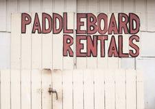 Arrendamentos de Paddleboard imagem de stock