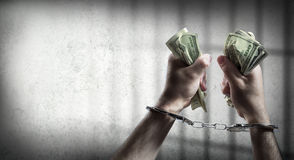 Arrest for corruption. Man handcuffed holding dollars Royalty Free Stock Image