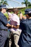 Arrest criminal. Dangerous criminal under arrest at gun point Stock Photos