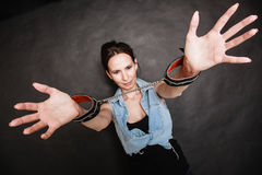 Arrest. Criminal woman prisoner showing handcuffs Royalty Free Stock Image