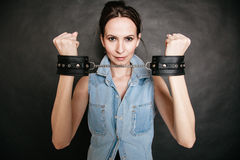 Arrest. Criminal woman prisoner showing handcuffs Royalty Free Stock Photography