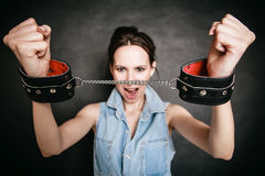 Arrest. Criminal woman prisoner showing handcuffs Royalty Free Stock Photos