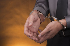 Arrest handcuffs Stock Images