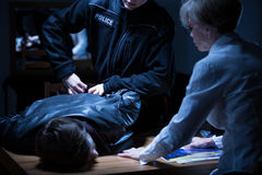 Arrest in interrogation room Stock Photos