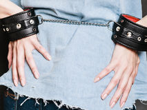 Arrest and jail. Closeup handcuffs on female hands Royalty Free Stock Image