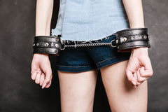 Arrest and jail. Closeup handcuffs on female hands Royalty Free Stock Images