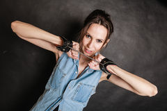 Arrest and jail. Criminal woman prisoner girl in handcuffs Stock Image
