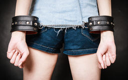 Arrest. Leather handcuffs on hands prisoner girl Royalty Free Stock Photography
