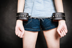 Arrest. Leather handcuffs on hands prisoner girl Stock Image