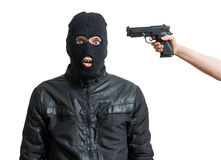 Arrested burglar or robber isolated on white background. Hand is aiming with pistol. Arrested burglar or robber isolated on white background. Hand is aiming stock images