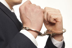 Arrested businessman. Arrested business man handcuffed hands. Close-up Stock Photography