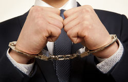 Arrested businessman. Arrested business man handcuffed hands. Close-up Royalty Free Stock Photo