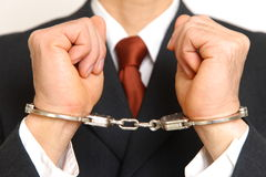 Arrested businessman. Concept shot of crime and justice Stock Image