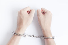 Arrested criminal hands in handcuffs Royalty Free Stock Photography