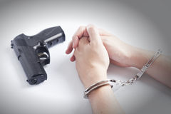 Arrested criminal hands in handcuffs Stock Photo