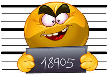 Arrested emoticon. With measuring scale in back holding his number posing for a criminal mug shot Royalty Free Stock Image