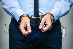 Arrested government official for corruption. Money out of pockets Royalty Free Stock Images