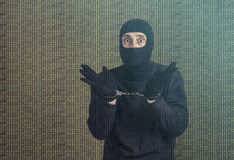 Arrested hacker. Hacker with handcuffs. Cyber attack and data security concept Royalty Free Stock Image