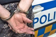 Arrested and handcuffed man. Close-up Stock Photo